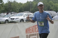 Committee Member, Duncan Payne, finishing the Timberman 70.3 half-ironman